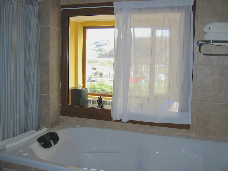 Even bathrooms have large picture windows that look through the room out the picture windows.