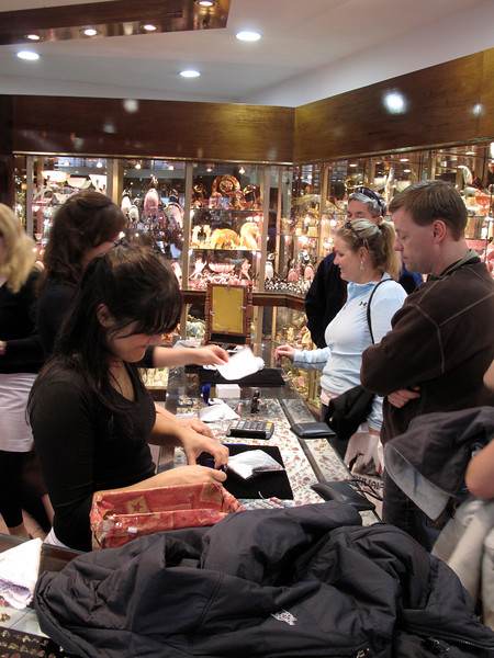 Here, some shoppers are lured into purchasing some of the many carvings from the stone.