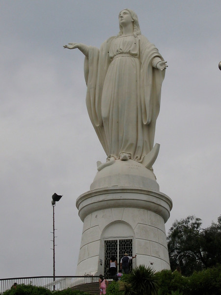 On its summit there is a sanctuary dedicated to the Immaculate Conception, with 22 meter statue of the Blessed Virgin Mary, an amphitheater and chapel. The statue of the Immaculate Conception measures 14 meters tall, and the pedestal on which it rests, 8.3 meters. It weighs 36,610 kilograms.[2] On the pedestal there is a small chapel in which his holiness John Paul II prayed and blessed the city of Santiago on April 1, 1987. The statue is lit up at night by lights placed on its sides, allowing it to be viewed from all over Santiago both day and night.