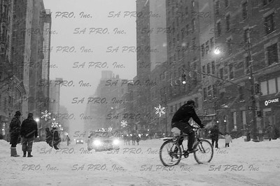 snow in New York City: food delivery messenger at the corner of 72nd Street & Colombus Avenue, Upper West Side