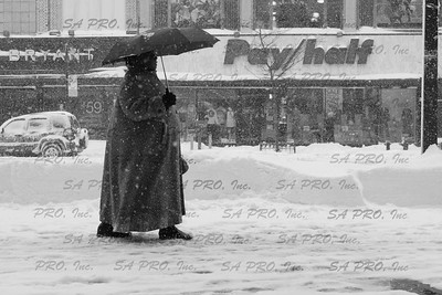 Walking on 125th street in Harlem, New York City during 2006 snow storm.