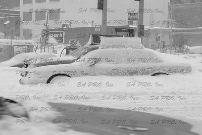 NY Yellow Cab under the snow in Harlem, New York during 2006 snow storm.
