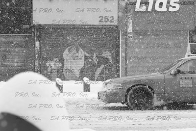 NY Yellow Cab on 125th street in Harlem, New York City during 2006 snow storm.
