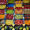 Fruits background in boxes display at market