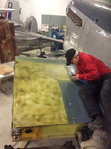Nelson riveting a new panel on.