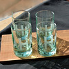A few monogrammed drink glasses made by sand blasting.