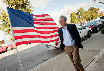 BAKERSFIELD, CA--- Rep. Kevin McCarthy walks down E. 19th St. in downtown Bakersfield past an American flag. McCarthy has been appointed the Chief Deputy Republican Whip for the 111th Congress. It was just eight years ago when he was elected to the California Assembly. McCarthy is a gregarious, energetic, GOP member that sleeps five hours a night and would rather discuss policy  and not politics.