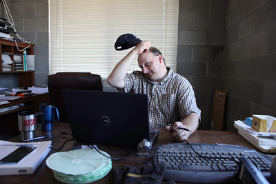 """Delhi,CA--Ray Prock, Jr. checks his computer in his office and is a second generation dairy farmer who runs Ray-Lin dairy and is on a mission to empower farmers use social media to tell their stories. Prock is widely popular in agriculture circles with a Twitter following of some 11,000 subscribers. Prock says he treats his 500 Holstein and Jersey cows well and runs a green operation. Prock's has blog postings dealing with """"the Animal Rights activists use of sensationalism,"""" on his Wordpress blog."""