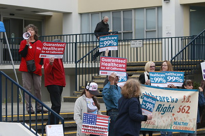 Rally organizer Kathryn Donahue speaks through a megaphone at a SB 562 rally in front of the Humboldt County Courthouse in Eureka on Monday morning.(Hunter Cresswell - The Times-Standard)