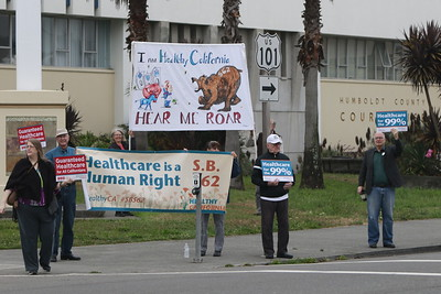 About 60 people rallied at the Humboldt County Courthouse in Eureka in support of SB 562, the single payer health care bill stalled in state Legislature, on Tuesday morning. (Hunter Cresswell - The Times-Standard)