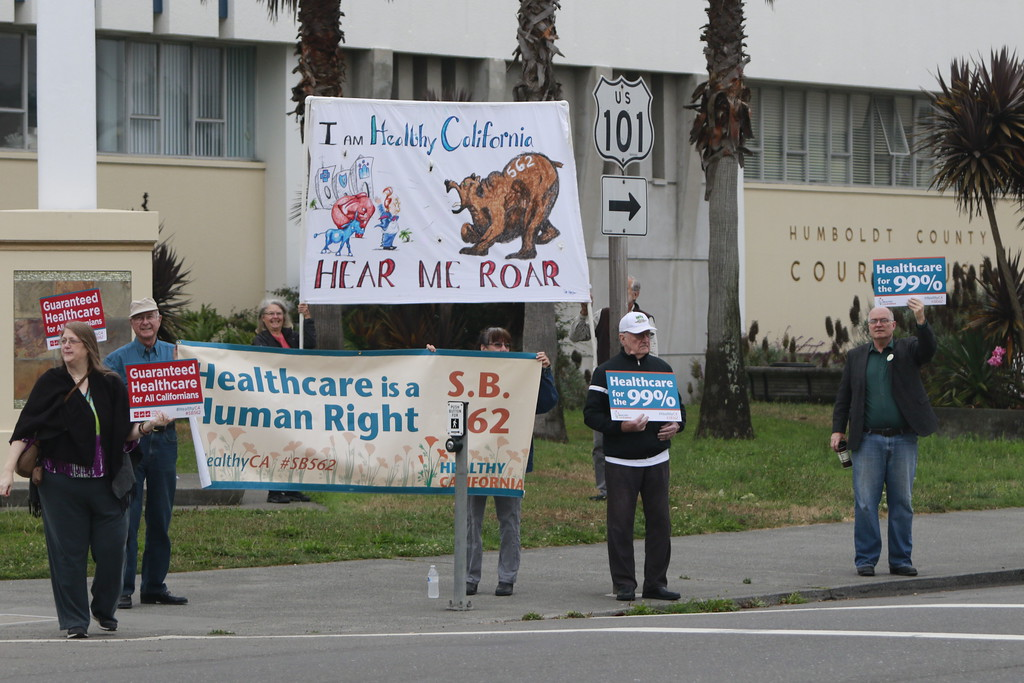 . About 60 people rallied at the Humboldt County Courthouse in Eureka in support of SB 562, the single payer health care bill stalled in state Legislature, on Tuesday morning. (Hunter Cresswell - The Times-Standard)