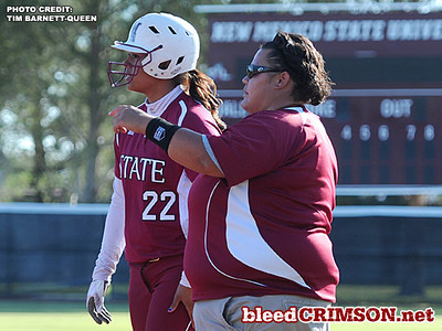 Tina Cisneros (22) receives instruction from assistant coach Tiala Tongaloa
