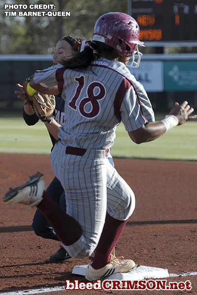 Amber Olive (18) tries to beat the throw to first base<br /> <br /> Photo Credit: Tim Barnett-Queen