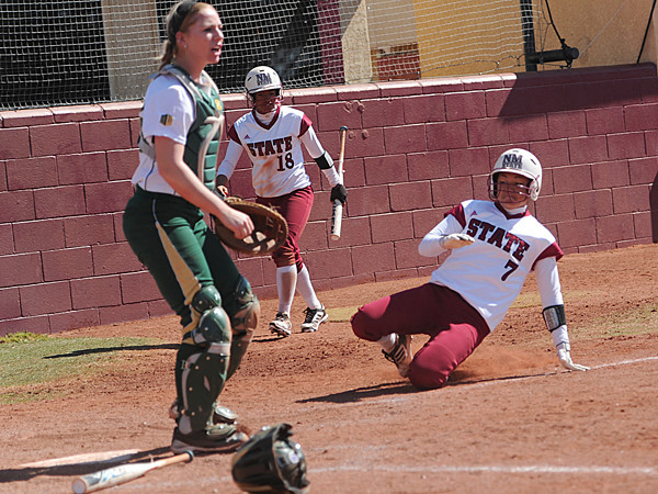 Brenna Nakamura (7) slides into home plate.<br /> <br /> Photo Credit: Tim Barnett-Queen