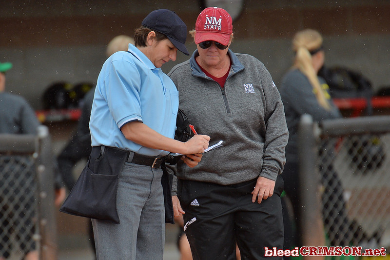 March 6, 2016: NM State associate head coach Cat Heifner goes over lineup changes with the home plate umpire in a game between New Mexico State and No. 7 Oregon at the 2016 Alexis Park Resort Classic at Eller Media Stadium in Las Vegas, Nevada. The Aggies lost to the Ducks 8-0 via run rule.