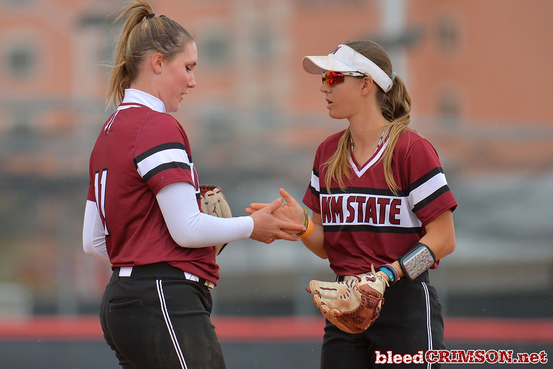 March 6, 2016: NM State pitcher Makayla McAdams (left) and third baseman Emma Adams (right) exchange a ritual handshake between batters in a game between New Mexico State and No. 7 Oregon at the 2016 Alexis Park Resort Classic at Eller Media Stadium in Las Vegas, Nevada. The Aggies lost to the Ducks 8-0 via run rule.
