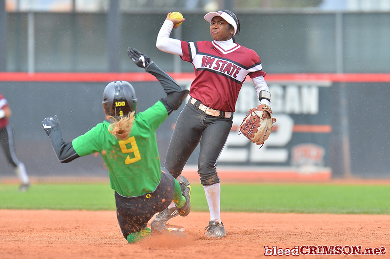 March 6, 2016: NM State second baseman tries to turn a double play in a game between New Mexico State and No. 7 Oregon at the 2016 Alexis Park Resort Classic at Eller Media Stadium in Las Vegas, Nevada. The Aggies lost to the Ducks 8-0 via run rule.