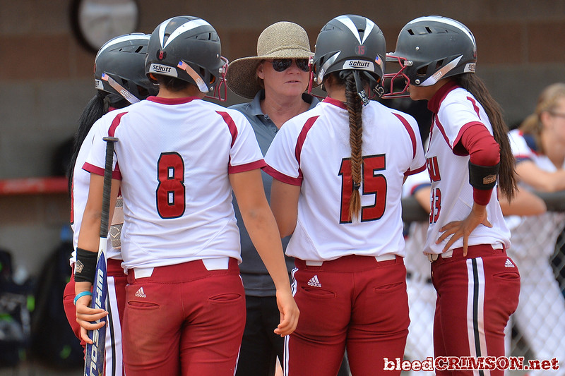 March 5, 2016: NM State associate head coach Cat Heifner talks with her offense in a game between New Mexico State and Saint Mary's College at the 2016 Alexis Park Resort Classic at Eller Media Stadium in Las Vegas, Nevada. The Aggies defeated the Gaels via run rule 12-4.