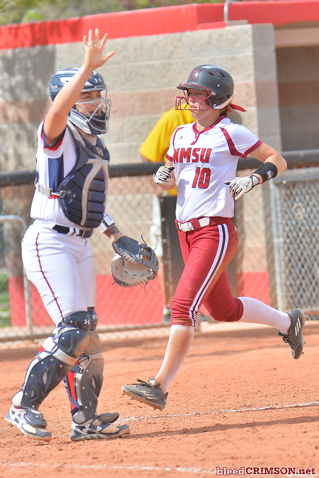March 5, 2016: NM State pinch runner Amy Bergeson crosses home plate to score a run in a game between New Mexico State and Saint Mary's College at the 2016 Alexis Park Resort Classic at Eller Media Stadium in Las Vegas, Nevada. The Aggies defeated the Gaels via run rule 12-4.