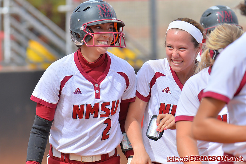 March 5, 2016: NM State catcher Alexis Maynez celebrates with a teammate after hitting a grand slam, her first career home run in the bottom of the first inning in a game between New Mexico State and Saint Mary's College at the 2016 Alexis Park Resort Classic at Eller Media Stadium in Las Vegas, Nevada. The Aggies defeated the Gaels via run rule 12-4.
