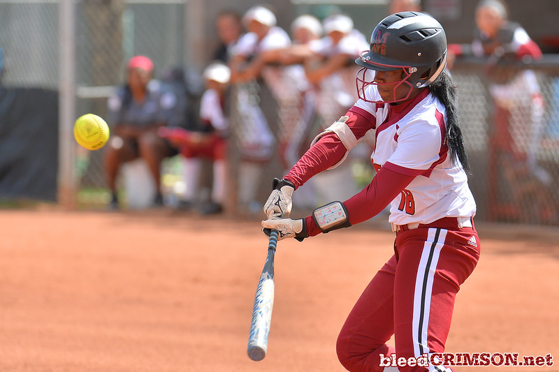 March 5, 2016: NM State second baseman Rachel Rodriguez slaps at a pitch in a game between New Mexico State and Saint Mary's College at the 2016 Alexis Park Resort Classic at Eller Media Stadium in Las Vegas, Nevada. The Aggies defeated the Gaels via run rule 12-4.