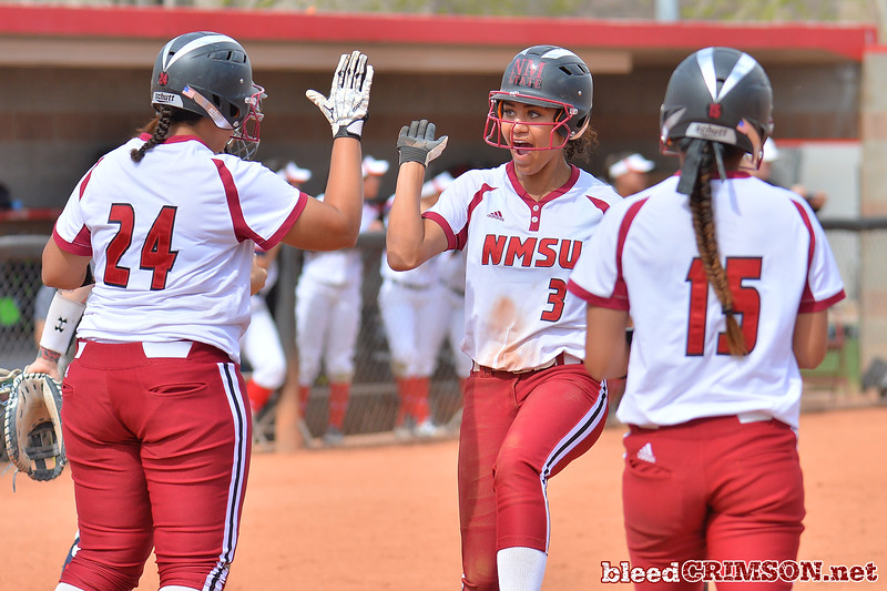 March 5, 2016: NM State center fielder Victoria Castro celebrates as she crosses the plate for a run in a game between New Mexico State and Saint Mary's College at the 2016 Alexis Park Resort Classic at Eller Media Stadium in Las Vegas, Nevada. The Aggies defeated the Gaels via run rule 12-4.