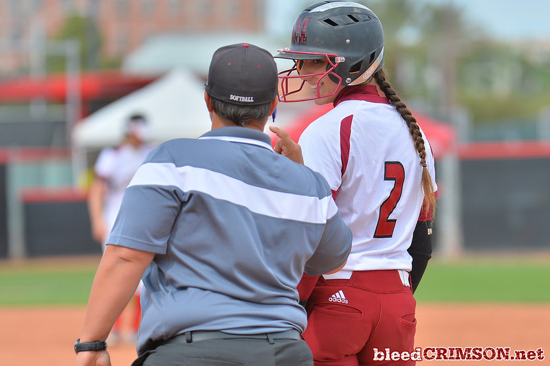 March 5, 2016: NM State catcher Alexis Maynez chats with first base coach Stef Ewing in a game between New Mexico State and Saint Mary's College at the 2016 Alexis Park Resort Classic at Eller Media Stadium in Las Vegas, Nevada. The Aggies defeated the Gaels via run rule 12-4.