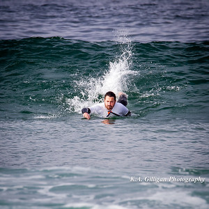 Surfer pulls into a wave at El Porto in Manhattan Beach, CA.