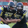 AHS QB #7 Brendan Piper stuffs #33 Jack Jewell - Algonac hosted Imlay City Football, September 9, 2016 (MIPrepzone photo gallery by David Angell)