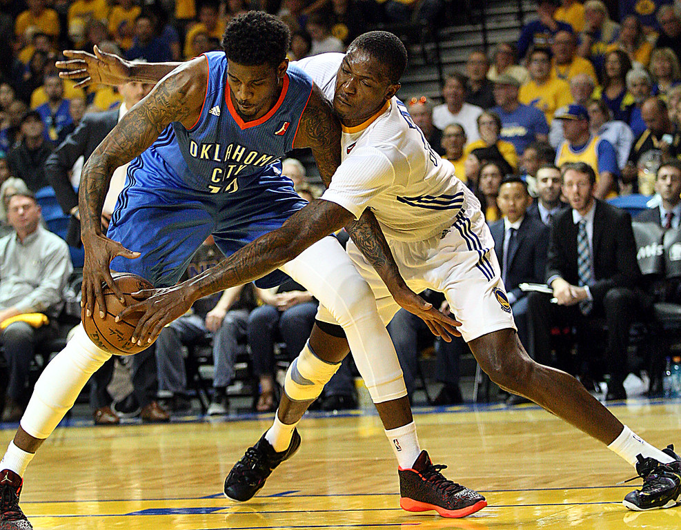 . Santa Cruz Warriors forward Chris Obekpa reaches isn to knock the ball away from Oklahoma City\'s  Solomon Jones during their D-League playoff game Wednesday night.  (Dan Coyro -- Santa Cruz Sentinel)