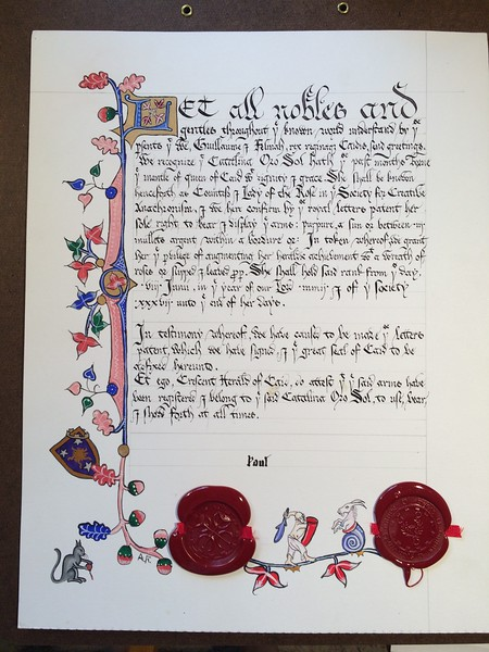 Countess Scroll for Catalina Oro Sol.  I just did the drop-cap.  The remainder of the illumination by Aliskye Rosel and Livia von Baden.  Calligraphy by Thomas Brownwell.
