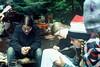 Camp life: drying boots, writing, banjo, huckleberries.<br /> <br /> Nina Yanai watches boots drying....