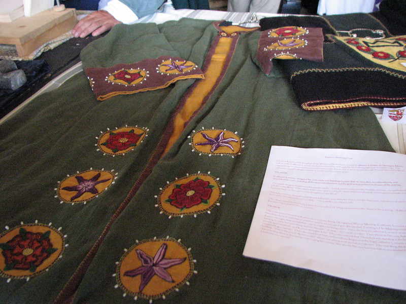 Pennsic A&S. Embroidered Persian Robe.  If you know who the artist is, please leave a comment.