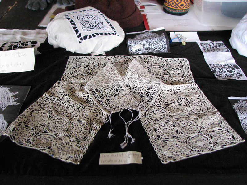 Pennsic A&S exhibit.  The marvelous needle lace by Arrienne Lenora Ashford.  I am a big fan or hers.  When I grow up, I want to produce art like that.