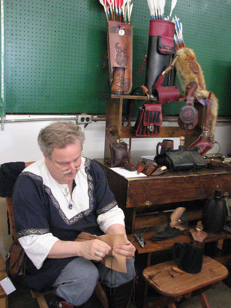 Baron Colum and his leatherwork display.