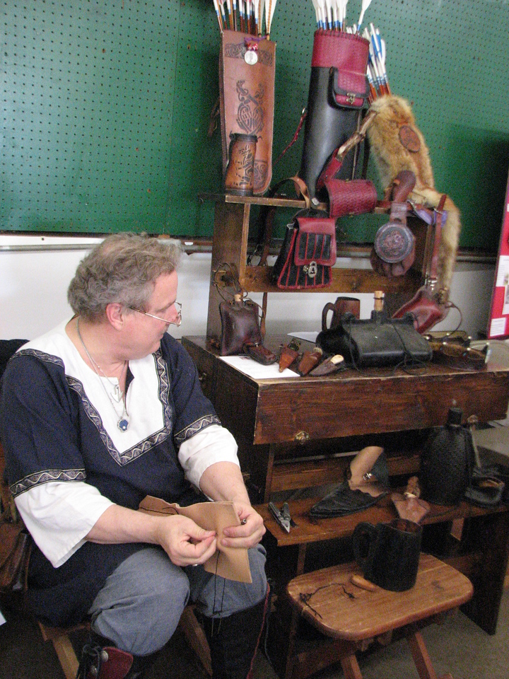 Baron Colum and his leatherwork display.