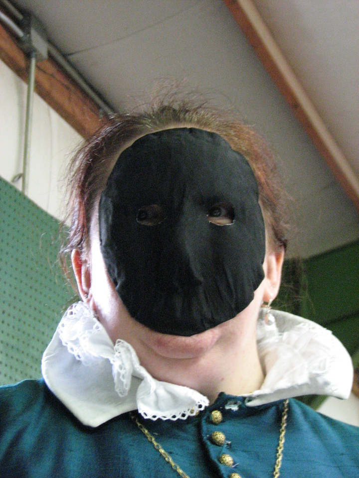 Beatriz in her best Dr. Doom impersonation.  (We soooo need to tour Pennsic in our masks!)