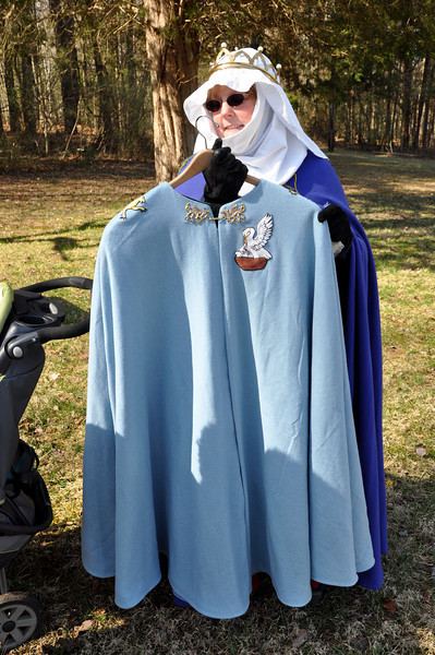 Greta showing the full cloak.  It's blue wool, lined in black linen.  Really gorgeous.