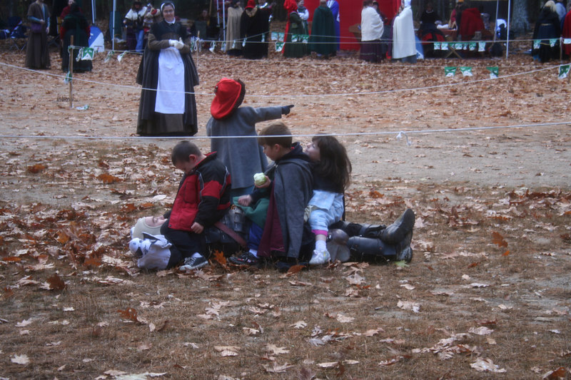 The children of the SCA tackle a fighter. One calls for reinforcements.