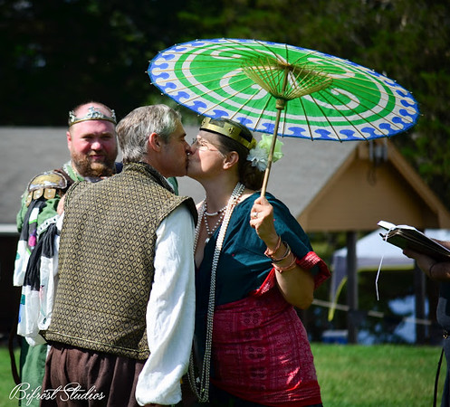 Robert kisses his wife, Countess Marguerite at the Ladies of the Rose Tourney 2015
