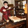 Master Iheronimus working on his printing Press