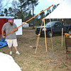 Malachi with his South Mississippi sand pole fishing for ground trout in the PVC spring he found next to my tent.