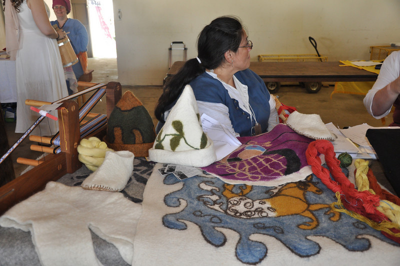 Virag's felting display.  Does anyone know who is the lady who is sitting with Virag's felting?