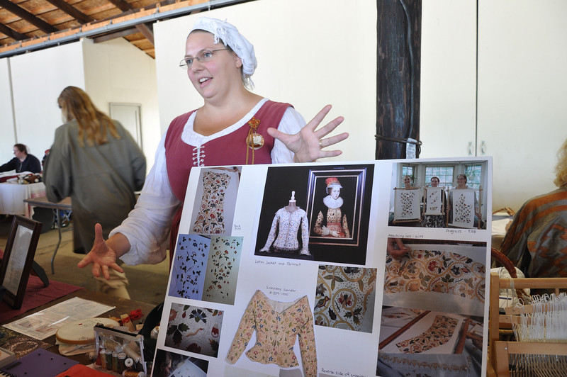 Mistress Genvieve d'Acquitaine and her embroidery display.