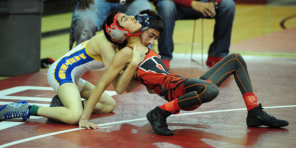 . (CHRIS RILEY �TIMES-HERALD) Vallejo\'s Abdur Rehman Khwaja tries to break free from Benicia\'s Brandon Reynolds during their 106 pound match in the Solano County Athletic Conference finals in Vallejo on Friday.