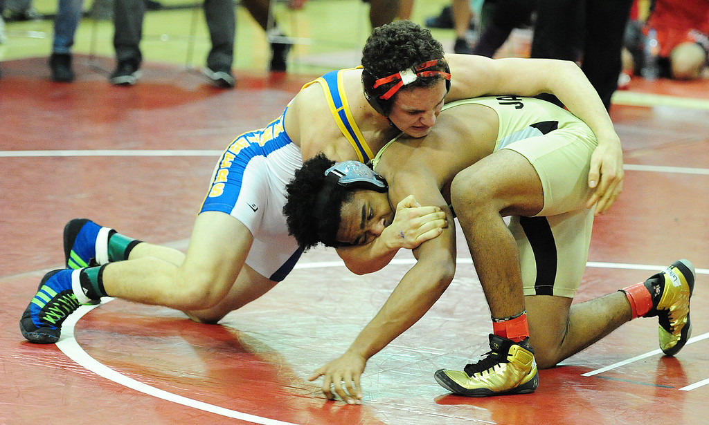 . (CHRIS RILEY �TIMES-HERALD) Benicia\'s Michael Rieder wraps up with Joseph Ector from Jesse Bethel during their 176 pound match at the Solano County Athletic Conference finals in Vallejo on Friday.