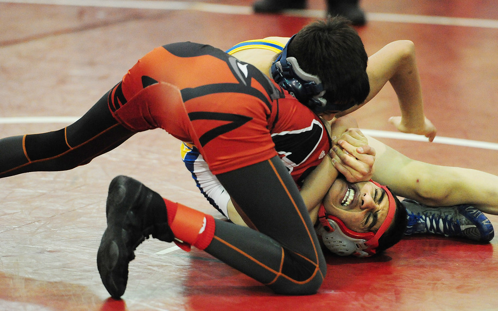 . (CHRIS RILEY �TIMES-HERALD) Benicia\'s Brandon Reynolds squeezes Vallejo\'s Abdur Rehman Khwaj during their 106 pound match in the Solano County Athletic Conference finals in Vallejo on Friday.