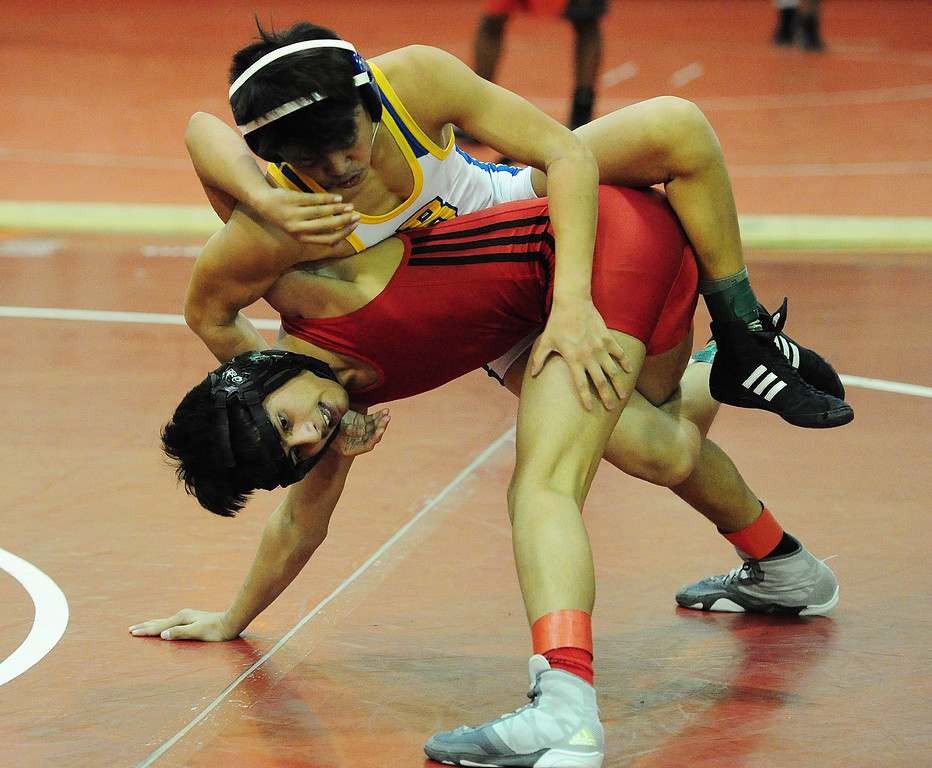 . (CHRIS RILEY �TIMES-HERALD) Fairfield\'s Mohammed Marini lifts up Benicia\'s Lorenzo Gunn during their 113 pound match at the Solano County Athletic Conference finals in Vallejo on Friday.