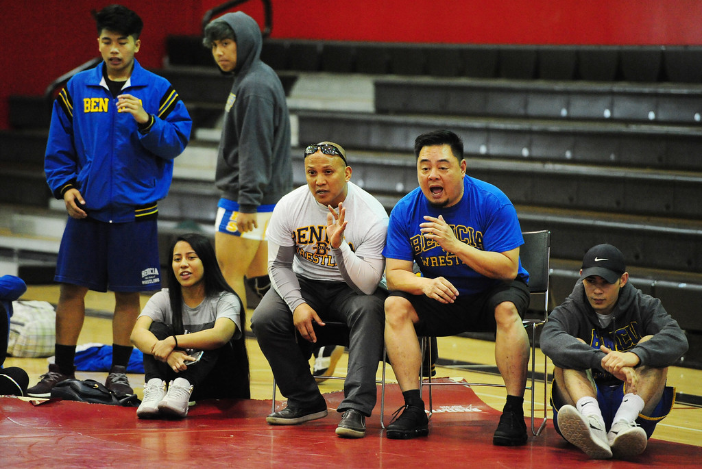 . (CHRIS RILEY �TIMES-HERALD) Benicia coaches yell instructions to a wrestler during the Solano County Athletic Conference finals in Vallejo on Friday.