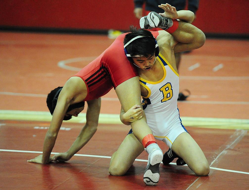 . (CHRIS RILEY �TIMES-HERALD) Benicia\'s Lorenzo Gunn lifts up Fairfield\'s Mohammed Marini during their 113 pound match at the Solano County Athletic Conference finals in Vallejo on Friday.